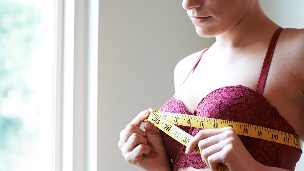 A woman measuring her bust